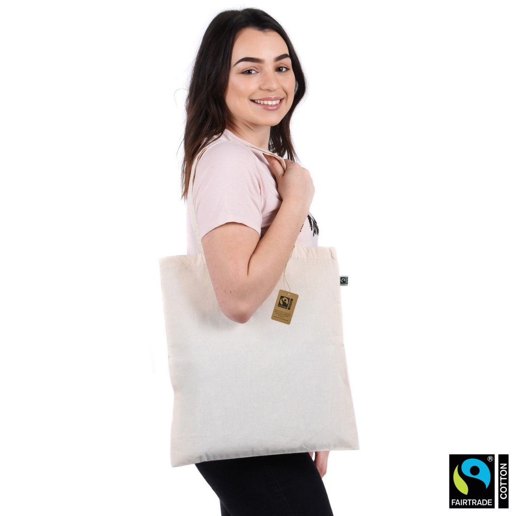 model wearing fairtrade and organic cotton bag